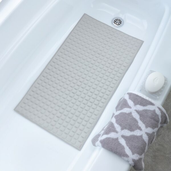 Gray Pillow Top Bath Mat In Tub with Towel and Soap Dish