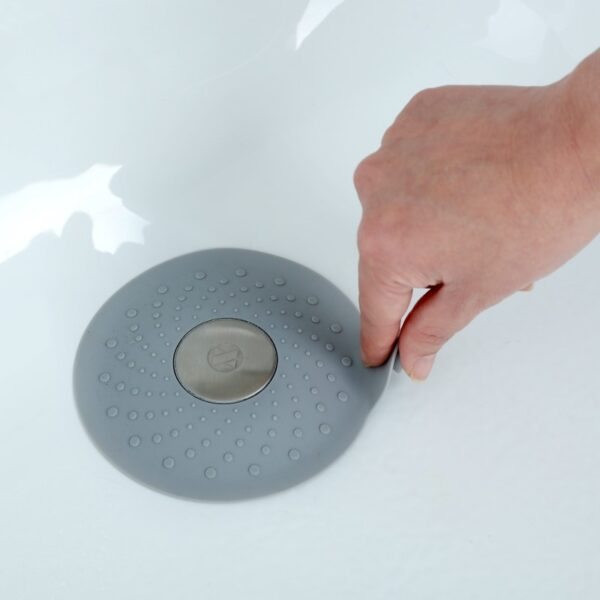 Seal-Tight-Drain-Stopper-Gray-Hand-on-Tab