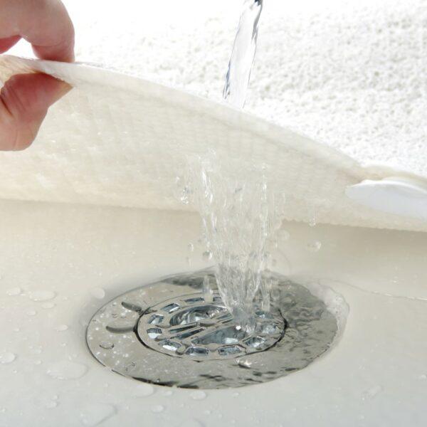 water flowing through cloud shaped shower mat