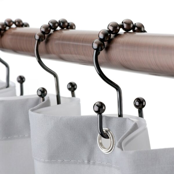 oil rubbed bronze double hooks on shower rod close up